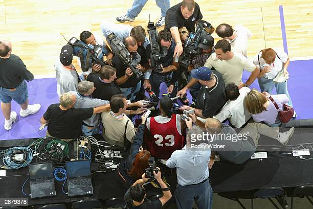 LeBron James of the Cleveland Cavaliers talks with the media before his NBA premiere against the Sacramento Kings at Arco Arena October 29 2003 in...
