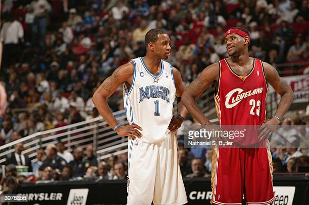 LeBron James of the Cleveland Cavaliers talks with Tracy McGrady of the Orlando Magic during the game at TD Waterhouse Centre on February 27 2003 in...