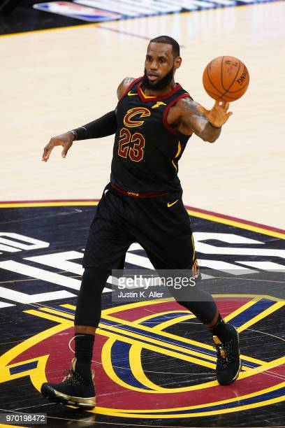 LeBron James of the Cleveland Cavaliers throws a pass against the Golden State Warriors during Game Four of the 2018 NBA Finals at Quicken Loans...