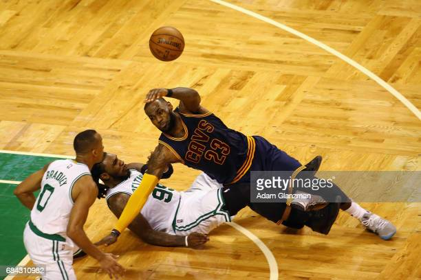LeBron James of the Cleveland Cavaliers throws the ball as he gets tangled up with Jae Crowder of the Boston Celtics in the second half during Game...