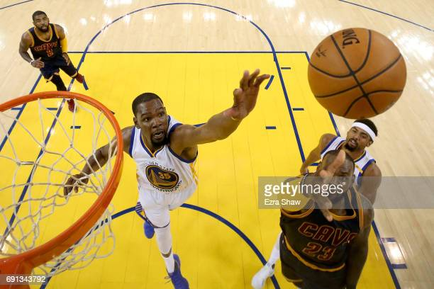 LeBron James of the Cleveland Cavaliers throws up a shot against Kevin Durant of the Golden State Warriors in Game 1 of the 2017 NBA Finals at ORACLE...