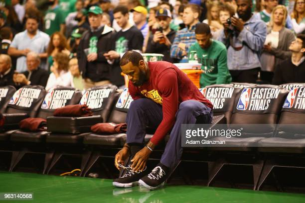 LeBron James of the Cleveland Cavaliers ties his shoes prior to Game Seven of the 2018 NBA Eastern Conference Finals against the Boston Celtics at TD...
