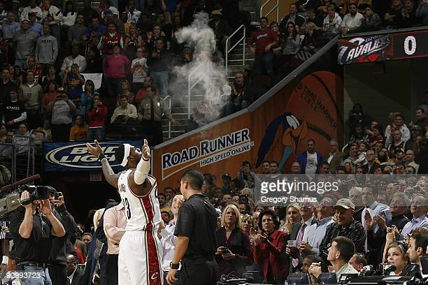 LeBron James of the Cleveland Cavaliers tosses talcum powder in the air prior to the game against the Chicago Bulls on November 5, 2009 at the...