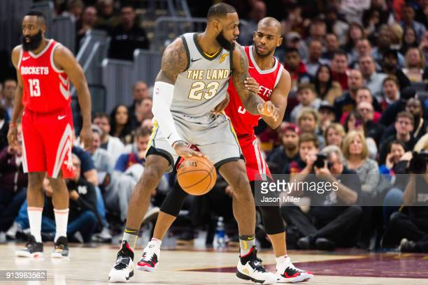 LeBron James of the Cleveland Cavaliers tries to drive around Chris Paul of the Houston Rockets during the first half at Quicken Loans Arena on...