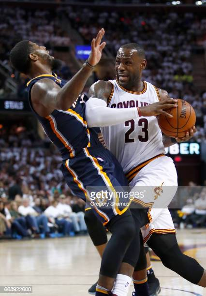 LeBron James of the Cleveland Cavaliers tries to drive through Paul George of the Indiana Pacers during the second half in Game One of the Eastern...