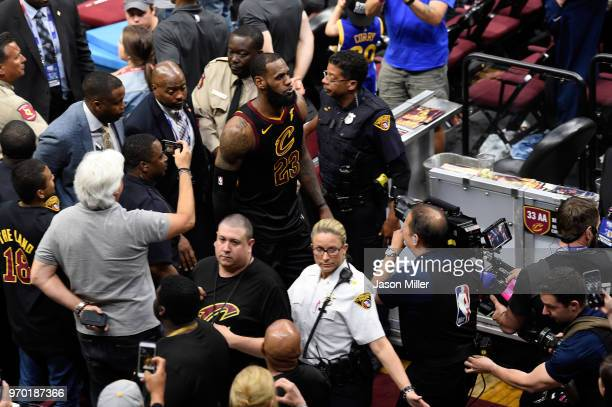 LeBron James of the Cleveland Cavaliers walks off the court after being defeated by the Golden State Warriors during Game Four of the 2018 NBA Finals...
