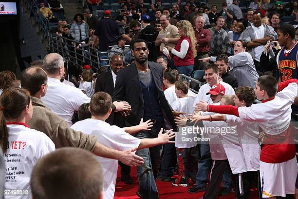 LeBron James of the Cleveland Cavaliers walks to the bench prior to the NBA game against the Milwaukee Bucks on March 6 2010 at the Bradley Center in...