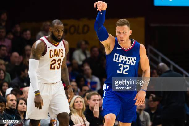 LeBron James of the Cleveland Cavaliers watches as Blake Griffin of the LA Clippers celebrates after hitting a three point shot during the second...