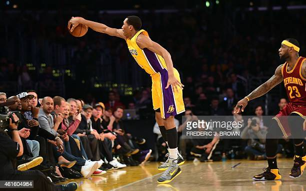 LeBron James of the Cleveland Cavaliers watches as Xavier Henry of the the Los Angeles Lakers keeps the ball in play during their NBA game at Staples...