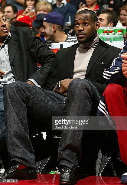 LeBron James of the Cleveland Cavaliers watches from the bench as his team plays the Toronto Raptors at the Air Canada Centre November 30 2007 in...