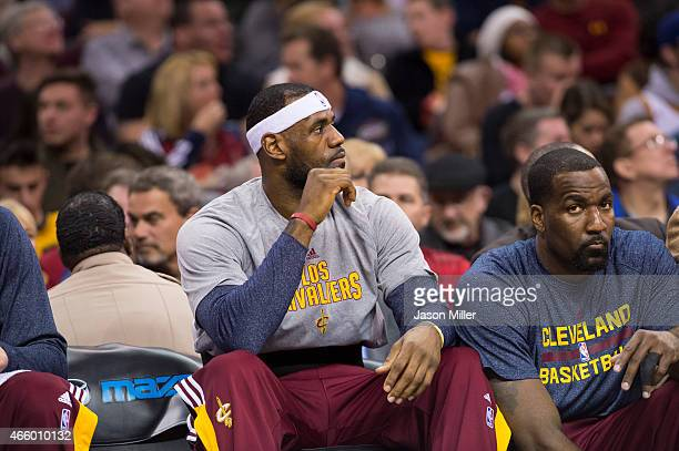 LeBron James of the Cleveland Cavaliers watches from the bench during the first half against the Phoenix Suns at Quicken Loans Arena on March 7 2015...