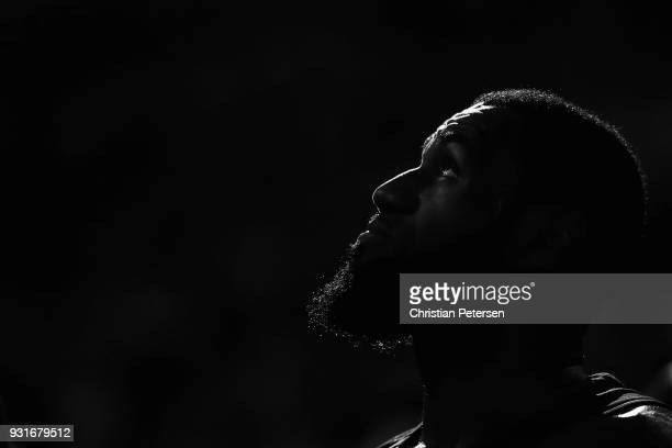 LeBron James of the Cleveland Cavaliers watches from the bench during a break from the second half of the NBA game against the Phoenix Suns at...