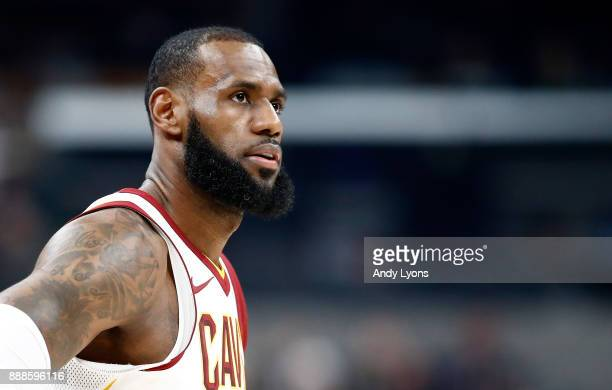 LeBron James of the Cleveland Cavaliers watches the action against the Indiana Pacers at Bankers Life Fieldhouse on December 8 2017 in Indianapolis...