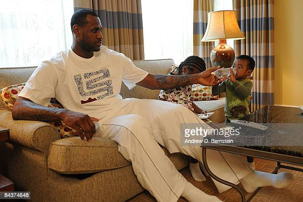 LeBron James of the Cleveland Cavaliers watches with his children Bryce and LeBron Jr the Inauguration of the 44th President of the United States...