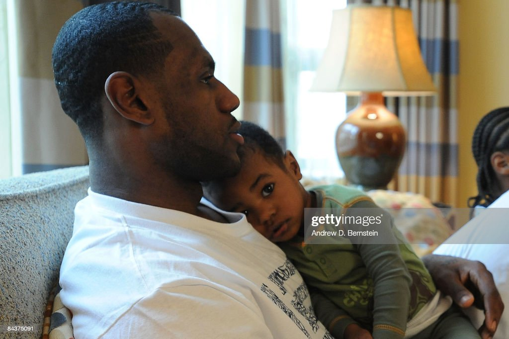 LeBron James #23 of the Cleveland Cavaliers watches with his son, Bryce, the Inauguration of the 44th President of the United States, Barack Obama, at the Beverly Wilshire Hotel on January 20, 2009 in Beverly HIlls, California.