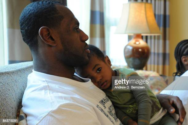 LeBron James of the Cleveland Cavaliers watches with his son Bryce the Inauguration of the 44th President of the United States Barack Obama at the...