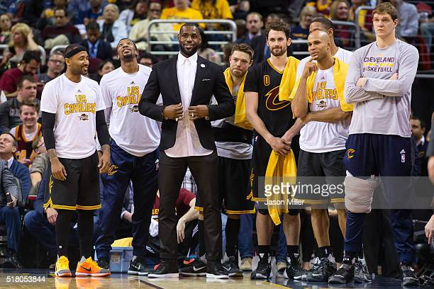 LeBron James of the Cleveland Cavaliers watches with his teammates from the bench during the first half against the Houston Rockets at Quicken Loans...