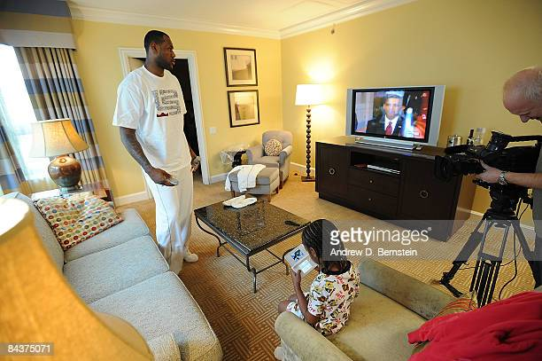 LeBron James of the Cleveland Cavaliers watches with son LeBron Jr the Inauguration of the 44th President of the United States Barack Obama at the...