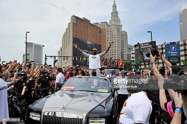 LeBron James of the Cleveland Cavaliers waves to the fans during the Cleveland Cavaliers Victory Parade And Rally on June 22 2016 in downtown...