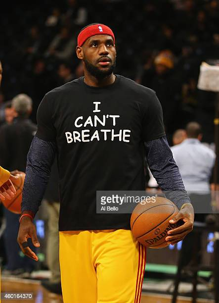 LeBron James of the Cleveland Cavaliers wears an 'I Can't Breathe' shirt during warmups before his game against the Brooklyn Nets during their game...