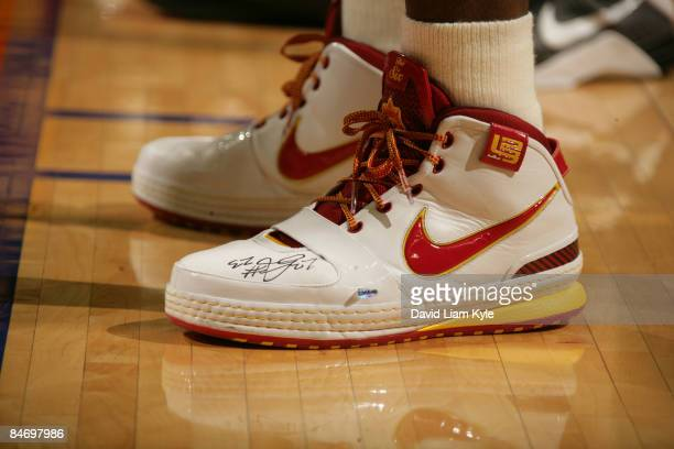 LeBron James of the Cleveland Cavaliers wears autographed shoes which will be auctioned off after the game against the Los Angeles Lakers at The...