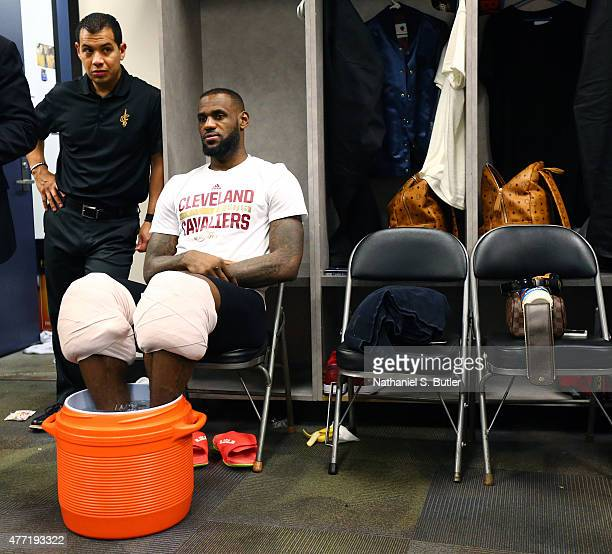 LeBron James of the Cleveland Cavaliers with his athletic trainer Mike Mancias in the locker room after Game Five of the 2015 NBA Finals on June 14...