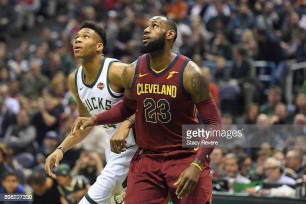 LeBron James of the Cleveland Cavaliers works against Giannis Antetokounmpo of the Milwaukee Bucks during a game at the Bradley Center on December 19...