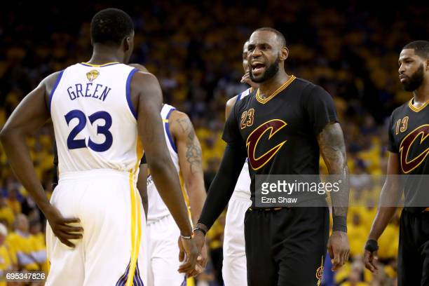 LeBron James of the Cleveland Cavaliers yells at Draymond Green of the Golden State Warriors in Game 5 of the 2017 NBA Finals at ORACLE Arena on June...