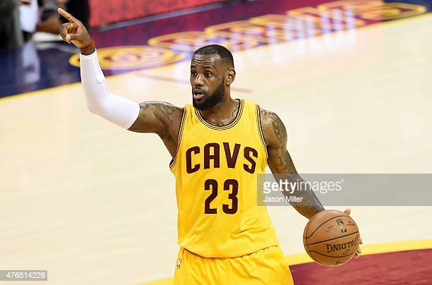 LeBron James of the Cleveland Cavaliers yells to his team during Game Three of the 2015 NBA Finals against the Golden State Warriors at Quicken Loans...