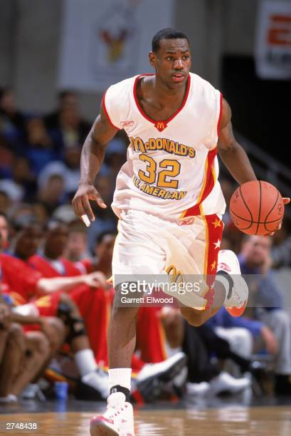 LeBron James of the East AllStars advances the ball up court against the West AllStars during the McDonald's AllAmerican High School Game on March 26...