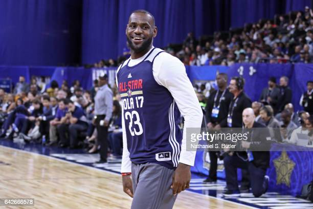 LeBron James of the Eastern Conference All Star Team smiles and walks on the court during NBA AllStar Practice as part of 2017 AllStar Weekend at the...