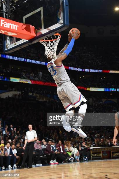 LeBron James of the Eastern Conference AllStar Team attempts a reverse dunk against the Western Conference AllStar Team during the NBA AllStar Game...