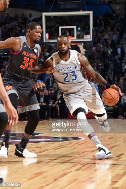 LeBron James of the Eastern Conference AllStar Team handles the ball against Kevin Durant of the Western Conference AllStar Team during the NBA...