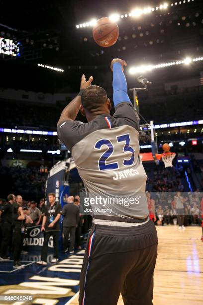 LeBron James of the Eastern Conference AllStar Team warms up before the NBA AllStar Game as a part of 2017 AllStar Weekend at the Smoothie King...