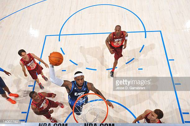 LeBron James of the Eastern Conference AllStars dunks against Chris Paul of the Western Conference AllStars during the 2012 NBA AllStar Game on...