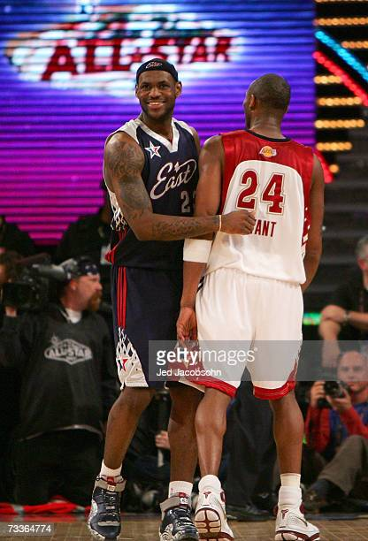LeBron James of the Eastern Conference and Kobe Bryant of the Western Conference share a laugh during the 2007 NBA All-Star Game on February 18, 2007...