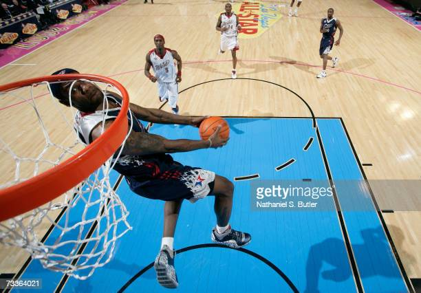 LeBron James of the Eastern Conference drives for a dunk against the Western Conference during the 2007 NBA All-Star Game on February 18, 2007 at the...