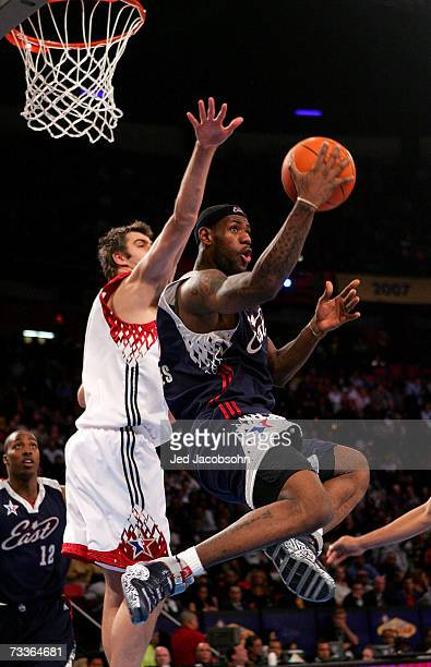 LeBron James of the Eastern Conference drives to the basket against Mehmet Okur of the Western Conference during the 2007 NBA All-Star Game on...