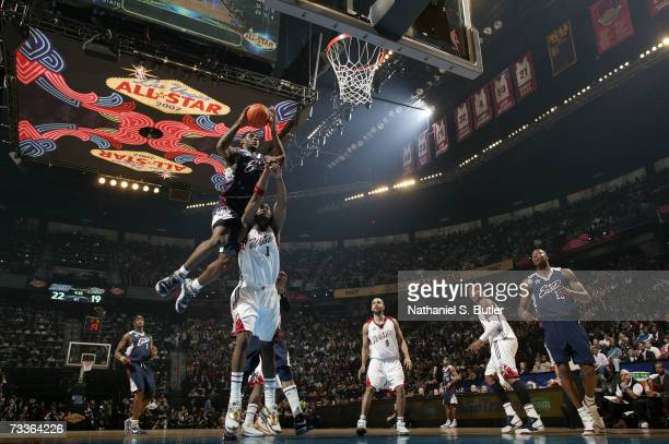 LeBron James of the Eastern Conference drives to the basket over Amare Stoudemire of the Western Conference during the 2007 NBA AllStar Game on...