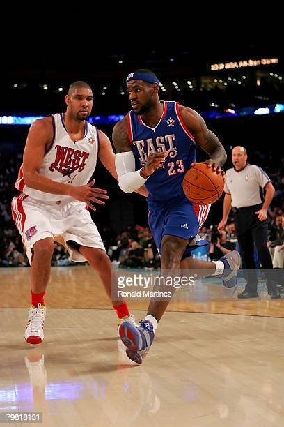 LeBron James of the Eastern Conference drives to the basket past Tim Duncan of the Western Conference during the 57th NBA AllStar Game part of 2008...