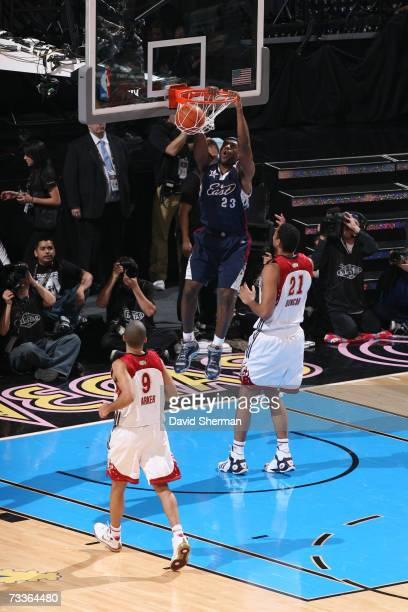 LeBron James of the Eastern Conference dunks against Tim Duncan of the Western Conference during the 2007 NBA All-Star Game on February 18, 2007 at...
