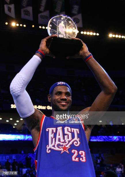 LeBron James of the Eastern Conference holds up his AllStar game MVP trophy after the East won the 2008 NBA AllStar Game part of 2008 NBA AllStar...