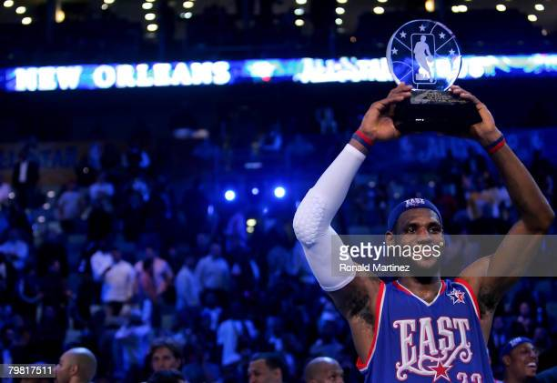 LeBron James of the Eastern Conference holds up the MVP trophy after the East won the 57th NBA AllStar Game part of 2008 NBA AllStar Weekend at the...