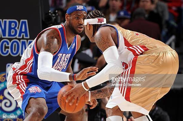 LeBron James of the Eastern Conference plays defense on Carmelo Anthony of the Western Conference during the 2008 NBA AllStar Game part of 2008 NBA...