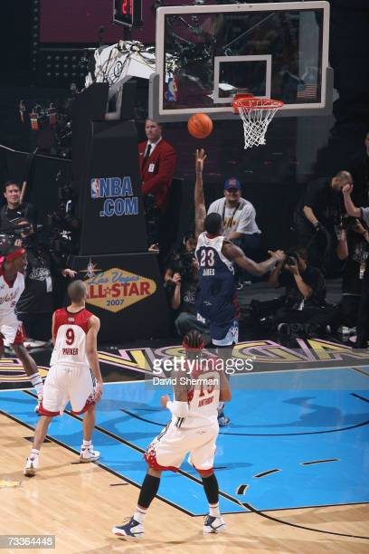 LeBron James of the Eastern Conference shoots against Carmelo Anthony of the Western Conference during the 2007 NBA All-Star Game on February 18,...