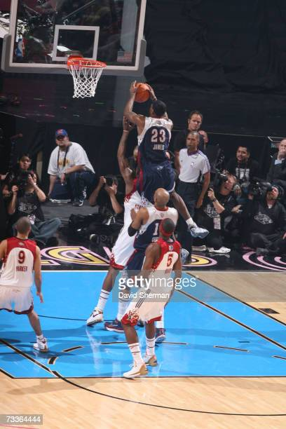 LeBron James of the Eastern Conference shoots against Josh Howard of the Western Conference during the 2007 NBA All-Star Game on February 18, 2007 at...