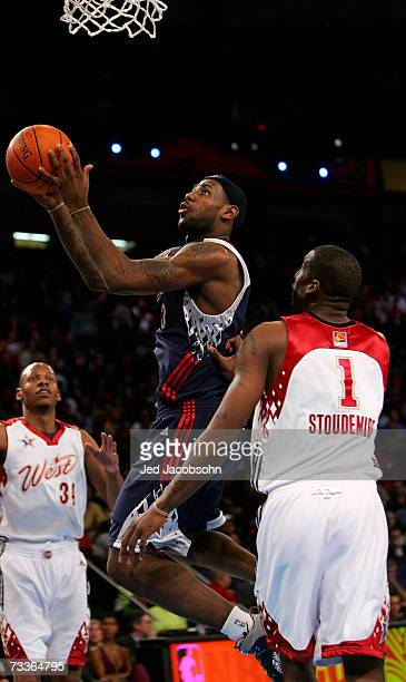 LeBron James of the Eastern Conference shoots over the defense of Amare Stoudemire and Ray Allen of the Western Conference during the 2007 NBA...