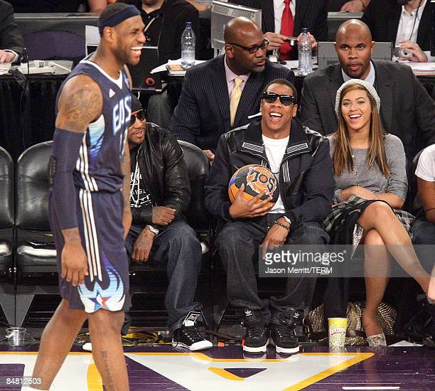 LeBron James of the Eastern Conference team, rapper Jay-Z, and singer Beyonce Knowles laugh during the 58th NBA All-Star Game, part of 2009 NBA...