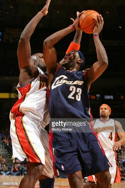 Lebron James of the Golden State Warriors goes up for the layup against Adonal Foyle of the Golden State Warriors on January 20 2006 at the Arena in...