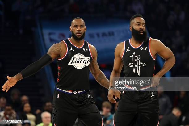 LeBron James of the LA Lakers and James Harden of the Houston Rockets both of Team LeBron look on as they play against Team Giannis in the first...